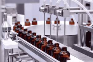 Elixinol CBD oil being bottled in a factory