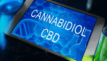 Tablet screen with text Cannabidiol CBD